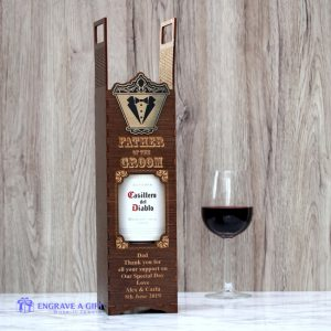 handmade dark stained vintage style wooden wine box personalised for father of the groom with gold embellishment attached engraved with tuxedo and bow tie